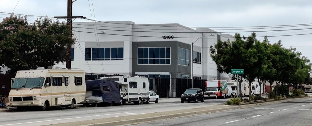 Campers outside of building - picture 1