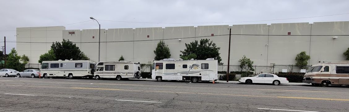 Campers outside building - picture 2